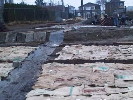 2013-02-01 moving gravel, mulch and concrete blocks